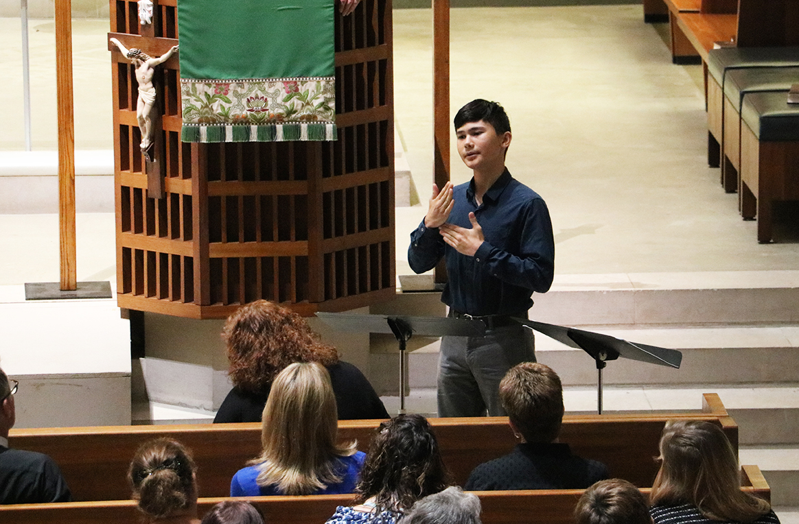 A church interpreting student interprets in front of a congregation
